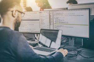 Programmer working on website coding